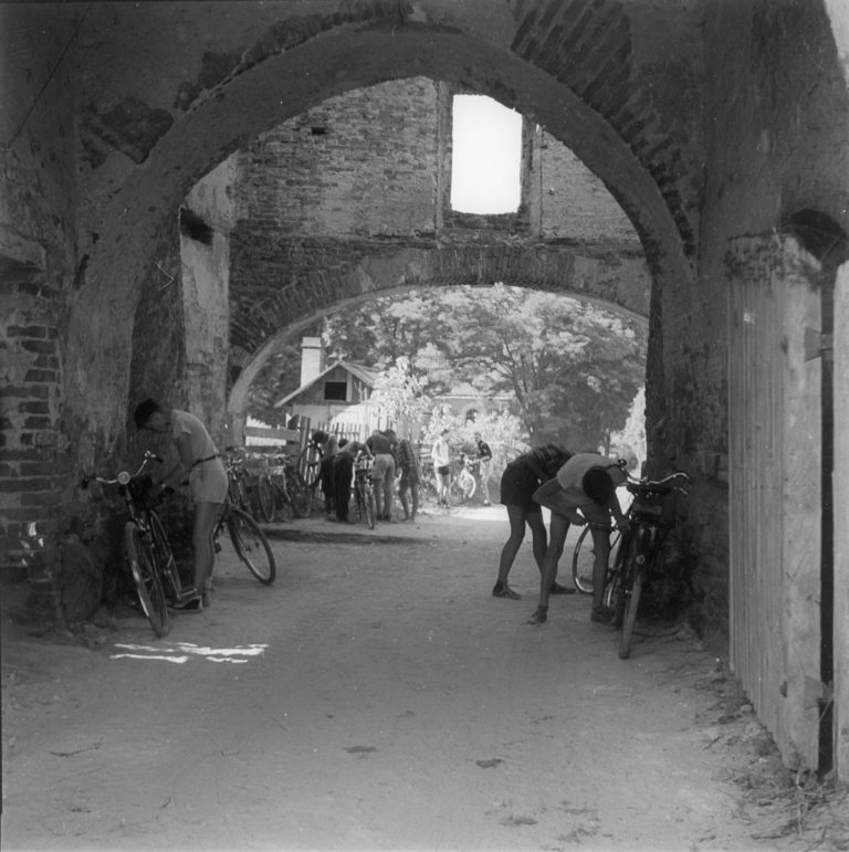 Cyclists in monastery
